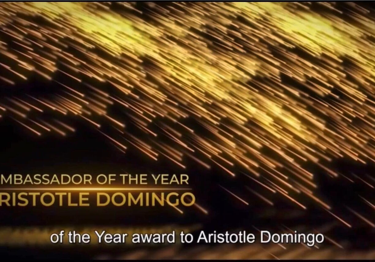 an image of sparklers. There is text on the page. It reads: Ambassador of the Year Award. Aristotle Domingo.