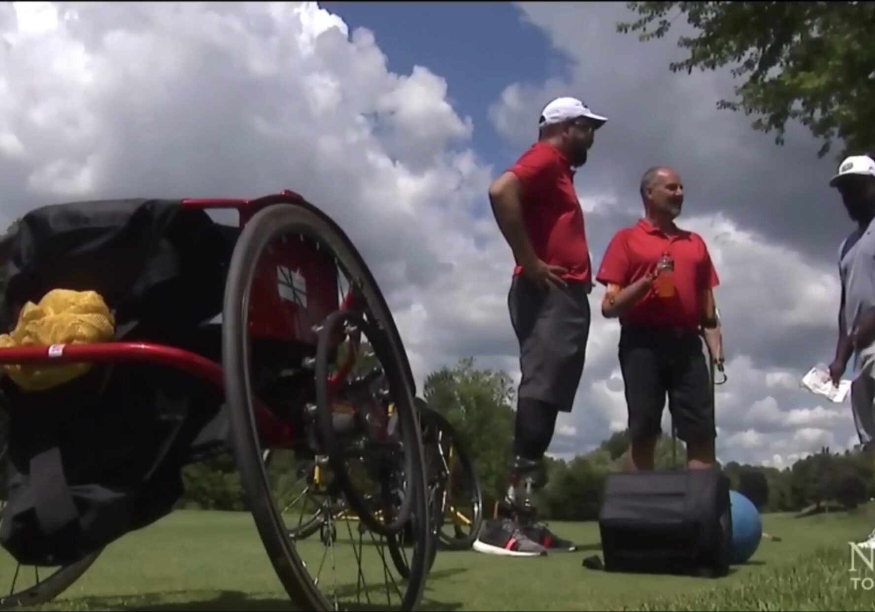 a racing wheelchair and an amputee standing