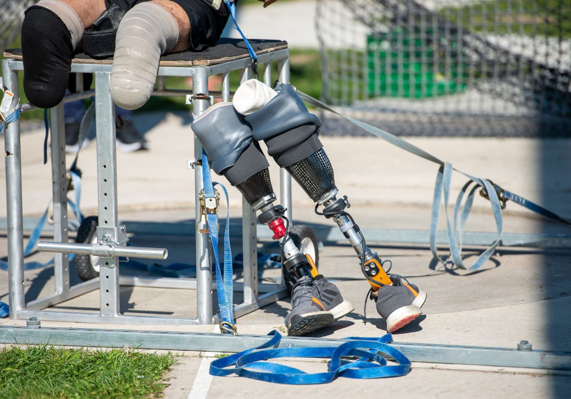 Two prosthetic leas leaning on a throwing chair.