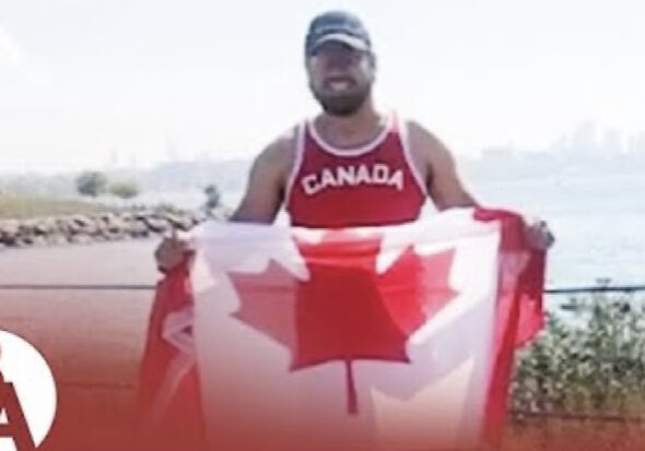 Aristotle holding a Canadian flag
